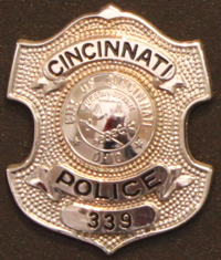 """Police Officer Clifford W. George""""s badge"""